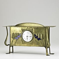 """ENGLISH ARTS & CRAFTS; Mantle clock, ca. 1900; Brass-washed copper, enamel, glass; Unmarked; 10"""" x 16 1/4"""" x 4 1/2"""""""
