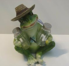 Senor Frog Wearing Sombrero Salt & Pepper Shaker Set by DWK. $12.22. Measures about 8.5 inches tall. Metal tops. Great Gift. Classic Pattern. Adorable Frog with Sombrero. What a fun set to add character to your home and kitchen.