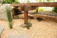 The deck extension is supported by beams bolted to a pier stepping with a metal foot onto a little boulder.