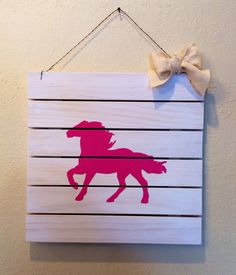 White washed pallets with hand painted hot pink horse.