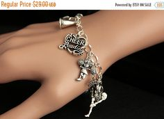 VALENTINE SALE Cheerleading Bracelet. Cheerleading Charm Bracelet. Cheerleader Bracelet. Silver Bracelet. Sports Jewelry. Handmade Jewelry. by GatheringCharms from Gathering Charms by Gilliauna. Find it now at http://ift.tt/2j5AWIy!