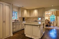 Decorations, Appealing Kitchen Remodeling Ideas With Laminate Wood Flooring White Stained Kitchen Island Table With Granite Top L Shaped White Stained Kitchen Cabinet With Bronze Kitchen Faucets Ceramic Ctile Backsplash Kitchen Window: Best Tips And Advice of Kitchen Remodeling for Your Home