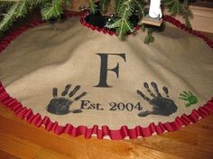 Family Tree skirt. Keep adding handprints as more members join the family! Love this idea.
