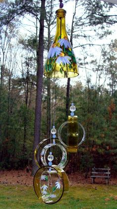 """Wind Chime, """"Lavender Lady """" , made from a recycled wine bottle - fashioned into a Wine-Chime Wine Bottle Chimes, Wine Bottle Art, Glass Bottle Crafts, Glass Bottles, Wine Art, Perfume Bottles, Carillons Diy, Easy Diy, Recycled Wine Bottles"""