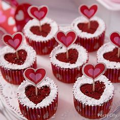 We're lovestruck for these red velvet cupcakes! Use a heart cutter to make a mini heart stencil from parchment paper. Place the heart in the center of the cupcakes & powder the cupcakes. Finish them off with a Cupid's arrow pick! <3