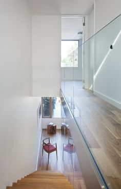 Glass walls instead of banisters to let more light through