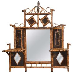 Beautiful 19th c. English Bamboo Mirror with Shelves | From a unique collection of antique and modern wall mirrors at https://www.1stdibs.com/furniture/mirrors/wall-mirrors/