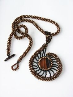 Beaded ammonite pendant  necklace
