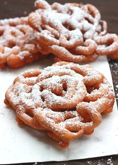 Funnel Cakes 2 cups oil for frying 1 large egg ⅔ cup milk 1-1/4 cups all-purpose flour 2 tablespoons granulated sugar 1 teaspoon baking powder ¼ teaspoon salt Confectioners' sugar, for dusting