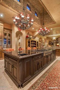 luxury rustic kitchen.  lighting and window treatments for this style shop DesignNashville.com