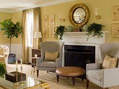 Love the warm and inviting glow of this happy yellow living room. Pops of green add needed freshness and acidity (sounds like a recipe, right?). Nice wainscoting gives some architectural detail to what I'd guess is a house built in the 1940s-1960s. Silk taffeta drapes are always welcome in my book, and adore a nautical style convex mirror framed by sconces. Another example of how houses do not need super high ceilings to be absolutely lovely.