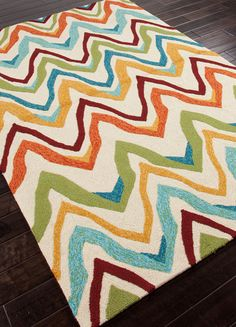 Catalog Code: CI18  Coastal Living , Jaipur rug    Contemp rug. Red , green , lime, orange, blue, teal , yellow, mustard