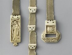 A 15th century belt of an abbess. Grey wool belt, with ivory fittings. (C) RMN-Grand Palais (musée de Cluny - musée national du Moyen-Âge) / Jean-Gilles Berizzi. It seems to be tablet woven...