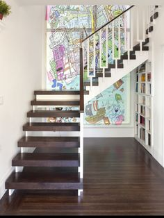 Make an 80's staircase look modern.  Bookcase in wall
