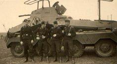 Armoured car crew pose for the camera.