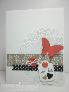 """Stamp Sets: Petite Pairs, Tiny Tags (r), Dot Dot Dot (r) Card Stock: Whisper White, Basic Black, Calypso Coral Ink Pads: Versamark Markers: Basic Black Tools: Big Shot, Hearts a Flutter Framelits, Heat Tool, Owl Builder, Elegant Butterfly, Heart to Heart (r), and 3/16"""" Corner (r) Punches Accessories: Tea Lace Doilies, White Embossing Powder, White Baker's Twine, Sycamore Street Buttons (r), Designer Printed Brads (r)"""