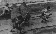 Jewish children forced to haul a wagon. Lodz ghetto, Poland, wartime.  Jewish children forced to haul a wagon. Lodz ghetto, Poland, wartime