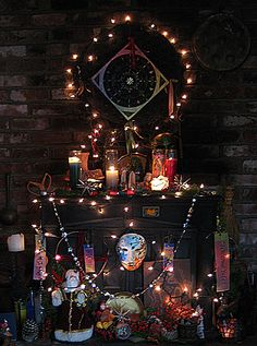 """""""Our hearth altar decorated for Yule. The Wheel of the Year mandala hangs on top"""""""