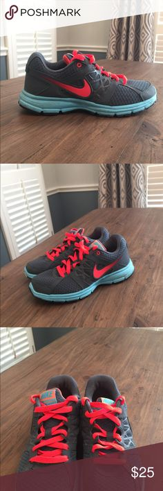NIKE Running Shoes These have been lightly used. I wore them mostly at the grocery store or running errands. They are in really great condition, very light wear. Dark Grey, neon Pink, turquoise Lace up athletics shoes. Nike Shoes Athletic Shoes