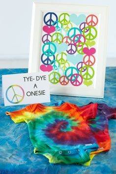 Tie-Dye Station. Create a tie-dye station with buckets of water, dye, rubber bands and white onesies.