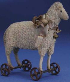 "1910 Steiff sheep on wheels, only 6"" . . .  love him!"