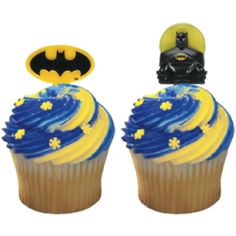 Batman cupcake picks Swirl blue and yellow frosting idea: 2 icing bags (one for each color), cut off the tips and place them inside the metal tip, tape it up so it stays in place