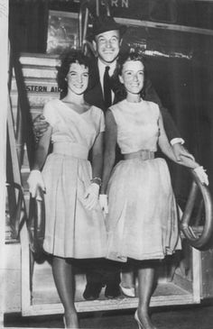 Gene Kelly (my most favoritest guy ever) with his wife and daughter.  This guy is just amazing!!  He represents true talent (singing, acting, AND dancing).  Can't we have more people like him in the world?