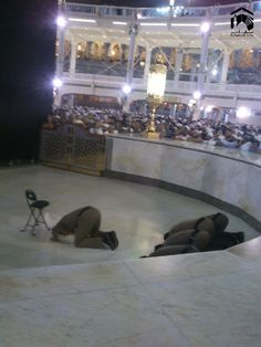 Guards at Masjidul Haraam pray inside Hateem in congregation