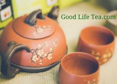 Yixing clay teapot and cups in a cherry blossom motif.  Spout and handles are modeled after tree branches.