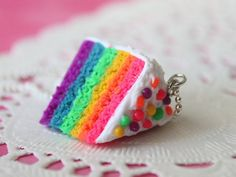 Rainbow cake necklace in super bright colors. So different from the others with creamy frosting and beautiful bubblegum as sprinkles. The piece has a