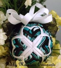 Heart Strings Quilted Ornament  This 3 inch ornament is layered in the Cathedral pattern with Black satin ribbon, white satin ribbon, and then layered in teal,white,black pattern fabric. The top is embellished with organza ribbon.  This ornaments comes gift boxed.  Price: $25.00 #ibhandmade