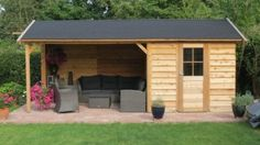 Lovely shed/ covered sitting area. Just the combo we're looking for!
