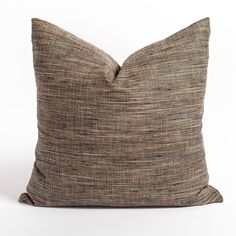 """This tan and black large backer pillow is subtle enough to hang back and let others shine but distinct enough to be front and center. A random slub blend together to give this fabric a grasscloth look and the smooth surface keeps the sturdy plain weave feeling more """"refined rustic"""" than rough and tumble. Condo Living Room, Large Sofa, Southwest Style, Bed Pillows, Weave, Fabric, Surface, Smooth, Rustic"""