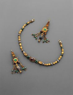 Hellenistic Jeweled Gold Necklace and Earrings, c. 1st Century BC - gold, emerald, garnet and agate; incredibly fine testament to the level of skill the goldsmith's craft - granulation, delicate wire work, polychromy, and even three dimensional molding and inlay – some of the most difficult and most beautiful techniques in goldwork!