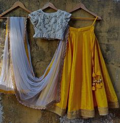 Yellow raw silk lehenga with a gorgeous gold border teamed with an off-white raw silk embroidered ruffle blouse with zardosi, pearl and sequins detail.Teamed with an ivory net dupatta.For your best friends wedding :)Composition:Lehenga, Blouse. Raw Silk Lehenga, Half Saree Lehenga, Yellow Lehenga, Indian Lehenga, Plain Lehenga, Lehnga Dress, Lehenga Blouse, Silk Dupatta, Indian Gowns Dresses
