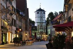 The old town center of Wangen in southern Germany is enclosed by a medieval wall with impressive clocktower gates. Many of the town's buildings are decorated with painted facades that reflect their historical heritage.