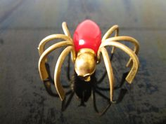 Vintage Bakelite Pin Red 3-D BRASS Spider Brooch/ Bakelite Pin/ Spider Pin/ by MISSIONMOD on Etsy https://www.etsy.com/listing/112589171/vintage-bakelite-pin-red-3-d-brass
