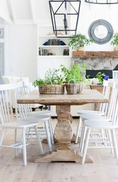 Lake house dining room with wide plank oak flooring, white board and batten walls and rustic table and grey dining chairs. Farmhouse Dining Room Table, Rustic Table, Dining Table, Dining Rooms, Beach Dining Room, Rustic Dining Chairs, Farmhouse Décor, Dining Decor, Kitchen Tables