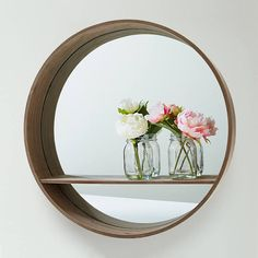 """""""Brighten up any room in your home with our round mirror and shelf. We've seen it styled in many ways and the flowers add a lovely touch! #kmartstyling…"""""""