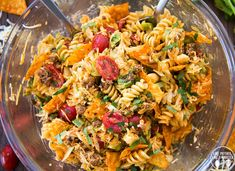 Taco Pasta Salad is a delicious pasta salad made with Mexican flavors, seasoned ground beef, crunchy doritos, and a delicious creamy dressing! Perfect for a summer potluck or BBQ!