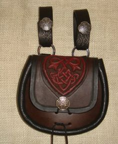 Hand tooled celtic heart sporran. $120.00, via Etsy.