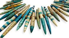 Staci Louise Smith hints that this dramatic new piece may be her Bead Dreams contest entry. These long pointed cigar shaped polymer beads are playfully carved and colored. Their marks, lines, crack...