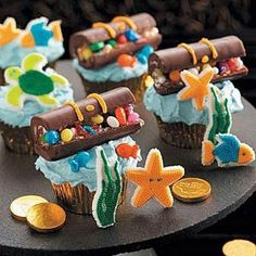 These are perfect for our mermaid and pirate party! Swiss cake rolls are cut and decorated with yellow tinted frosting and assorted candies. party-ideas-mermaids-and-pirates