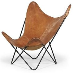 Leather Butterfly Chair. The Butterfly chair, designed in 1938 by Jorge Ferrari-Hardoy, also known as the BKF and the Hardoy chair.