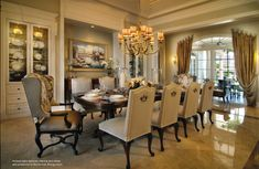 Various light sources, fabrics, and china add ambience to this formal dining room by P&H Interiors | Miami Design Magazine www.MiamiDesignMagazine.com