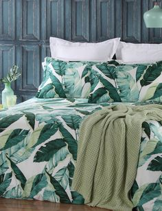 The Florence duvet cover set features tropical leaves that create a cool, calm paradise with a sense of relaxation and style. Soothing shades of green cover the duvet cover on a fresh white base.