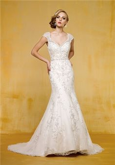 """""""fit and flare"""" means it hugs the curves but doesn't poof out at the bottom like """"mermaid"""" - this lace one is so romantic - do you like lace?"""