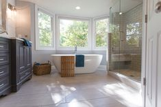 Modern Traditional Master Bathroom Designs | Large white soaking tub | construction2style