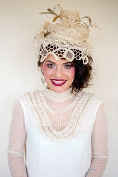 A victorian lace Fascinator with brooch and hat pin detailing from summer 2013 collection
