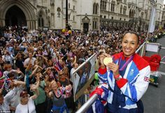 Heptathlete Jessica Ennis holds her gold medal during a parade as it passes the High Court in the City of London September 10, 2012.